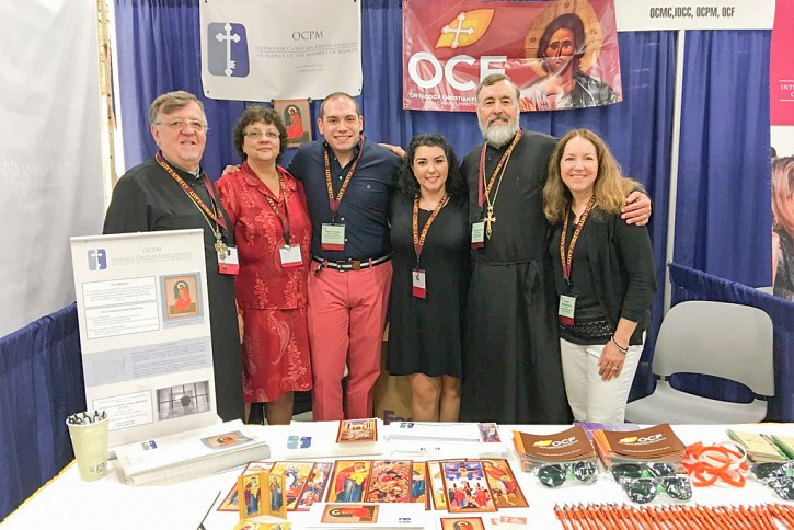 Photo L-R  Fr. John Kowalczyk, Secretary of the Board of Directors and Matushka Kathy, Paul Polites, Director of Operations, with Vicki Haskopoulos and Fr. Stephen Powley, Executive Director of OCPM, with Matushka Ashley