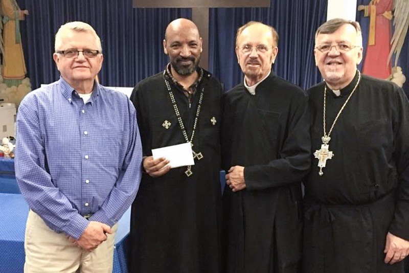 left to right: George Petorak, President of St. Michael's Church Council; Fr. Tesfalem; Protodeacon Gabriel Petorak; and Very Rev. John Kowalczyk.