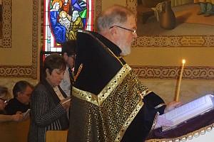 Very Reverend Vladimir Fetcho reads one of thePassion Gospels on Holy Thursday